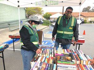 CERT volunteers Cathy and Ivan at the Book Exchange