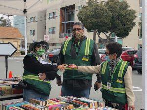 CERT volunteers sanitize their hands before gloving up!